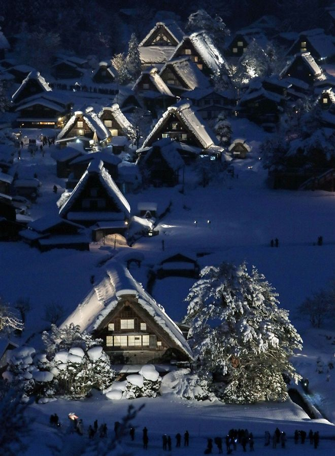 "Japanese traditional wooden houses, ""Gassho zukuri,"" are lit up in the snow-covered village of Shirakawa in Gifu prefecture, Japan"
