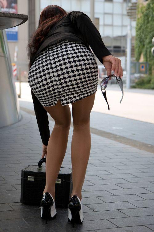Bent over in skirt