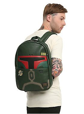 """Because bounty hunters need somewhere to carry all those wanted posters. Boba Fett would probably be pretty excited to carry this <i>Star Wars</i> backpack, since it has his own helmet printed on it. An embroidered patch, front zip pouch, and interior laptop sleeve make it the universe's most wanted backpack. <br><div><ul><li style=""""list-style-position: inside !important; list-style-type: disc !important"""">12 1/2"""" x 17""""</li><li style=""""list-style-position: inside !important; list-style-type…"""