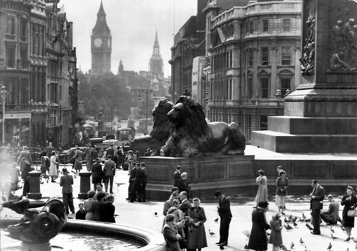 Trafalgar Square from 1950/51. Look closely and you'll see the paws of the lion are missing. They were taken away for repair in 1950 and had been damaged in a 1941 wartime bomb.