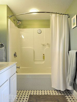 Durable, low-maintenance, inexpensive bathroom: one piece tub-shower unit, painted walls, tile floor. Like the curved shower curtain rod, too.
