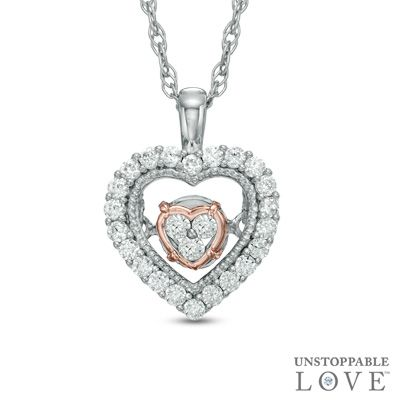 Unstoppable love 1 6 ct t w diamond heart pendant in 10k for Where is zales jewelry