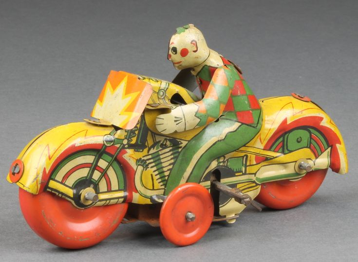 "Lot 300, A British made early 20th century clockwork tin plate model of a clown riding a motorcycle 5"", est £40-60"