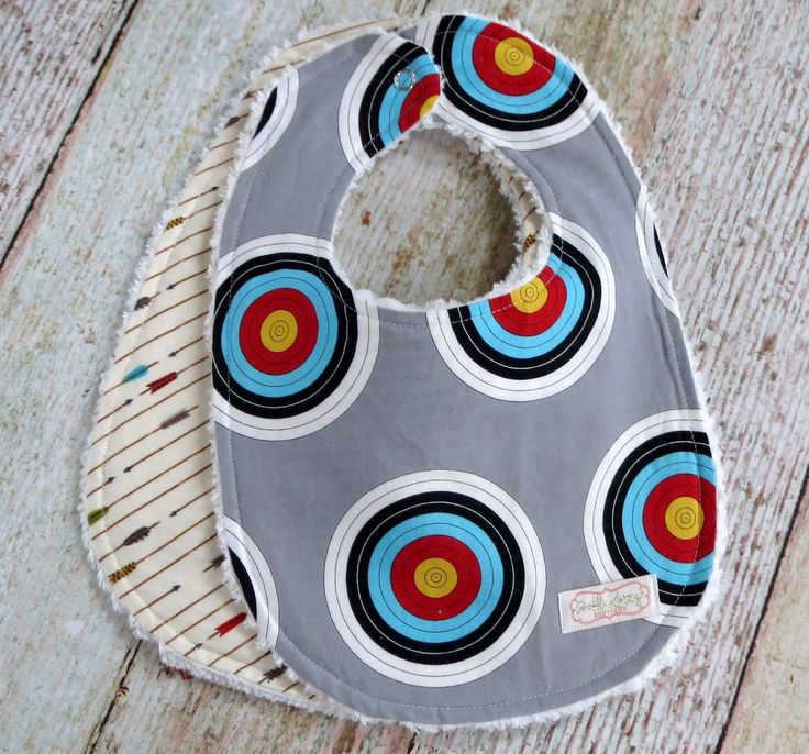 Super cute and sporty archery bib set for all the little baby boys out there. This super trendy baby boy bib set would make a great baby shower gift for that new or expecting mom. These chenille bibs
