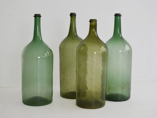 Vintage Glass Bottles  Made in Italy Dimension: 67H x 23 Diam  Handblown vintage glass bottles originally used for wine and vinegar.