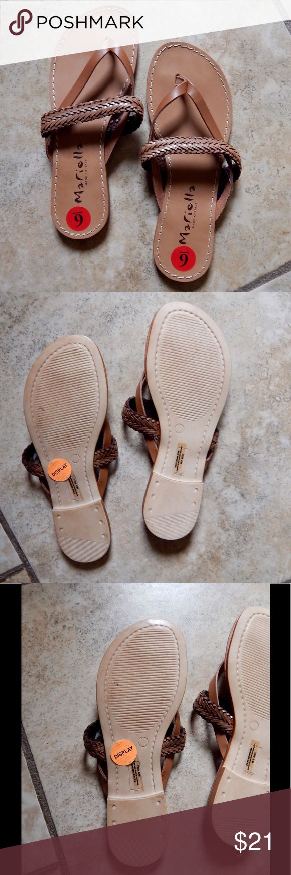 Mariella Brown Leather Flip Flops/Sandals Mariella Brown Leather Flip Flops.  Women's Size 6.  Italian.  Never worn, but the left sole shows dirt from being a display. Mariella Shoes Sandals