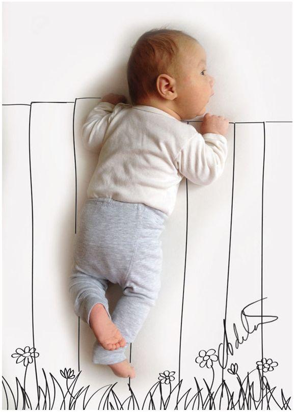 Baby hinterm Zaun