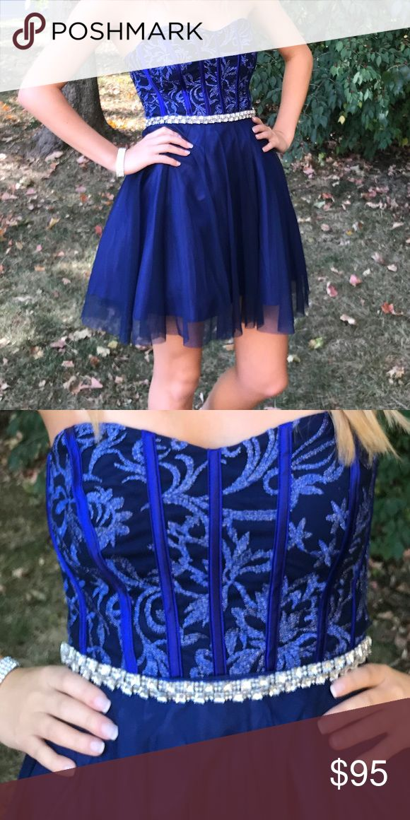 Homecoming Dress Blue & silver short homecoming dress. Size 2 and has an removable sparkly belt. Worn once and in perfect conditions. 2017 Dress from Dillards Dresses Strapless