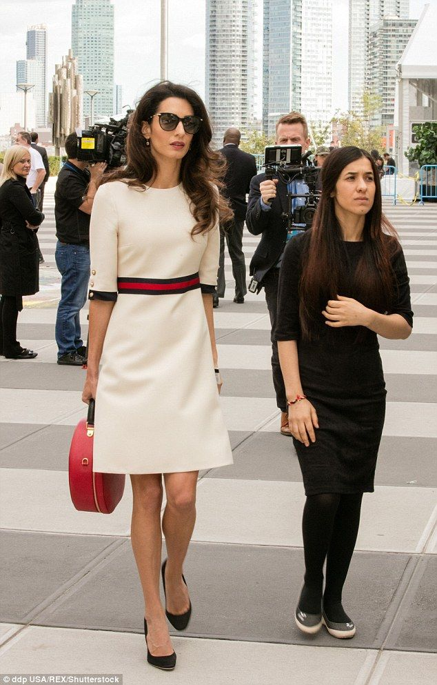 Style star: Amal displayed her slender pins in the stylish mini-dress as she carried her vintage inspired handbag to the event