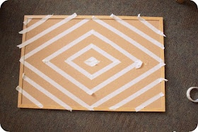 49 Dresses: spruce up a cork board with a little paint over masking tape