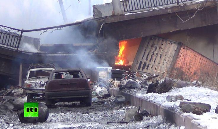 Russian destruction of the Putilovsky bridge because of Ukrainian  advance. 01.18.15. From Russian TV News.