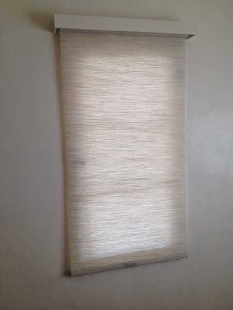 Simple Roller Shade In Textured Linen Natural With A Wood