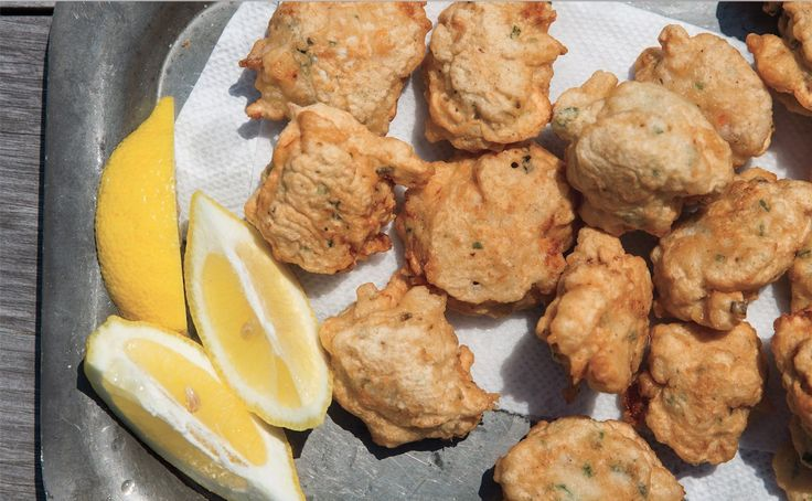 A masterful street food, Rhode Island clam fritters (aka clam cakes) aren't cakes at all — the best are briny Southern hush puppies. Think clam beignet:…