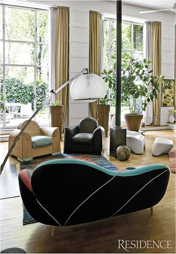 """Marc Sadler has designed for """"bigshots"""" like Nike and Foscarini. His stunning home is located in an old foundry outside Milan. (Design love; Javier Mariscal sofa from the series Los Muebles Amorosos. Black armchair from Dainese. Vintage lamp from the 1940s.)"""