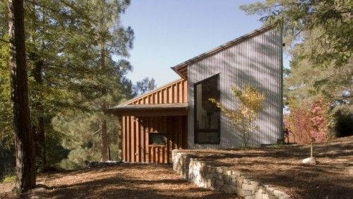 contemporary porch by Cathy Schwabe Architecture  note the use of board n' batten with corrugated metal