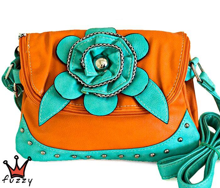 """Τσάντα γυναικεία σε πορτοκαλί και πράσινο χρώμα,  απομίμηση δέρμα, με μία μεγάλη θήκη με φερμουάρ που διπλώνει,  δύο θήκες εσωτερικά και μία πίσω εξωτερική με φερμουάρ.  Στολισμένη με ανάγλυφο λουλούδι και μεταλλικά καρφάκια. Κούμπωμα μαγνητικό  σε σχέδιο """"φάκελος"""". Μεγάλο λουράκι ώμου που αυξομειώνεται, φοριέται και χιαστί. Διαστάσεις 22Χ2Χ18 εκ."""