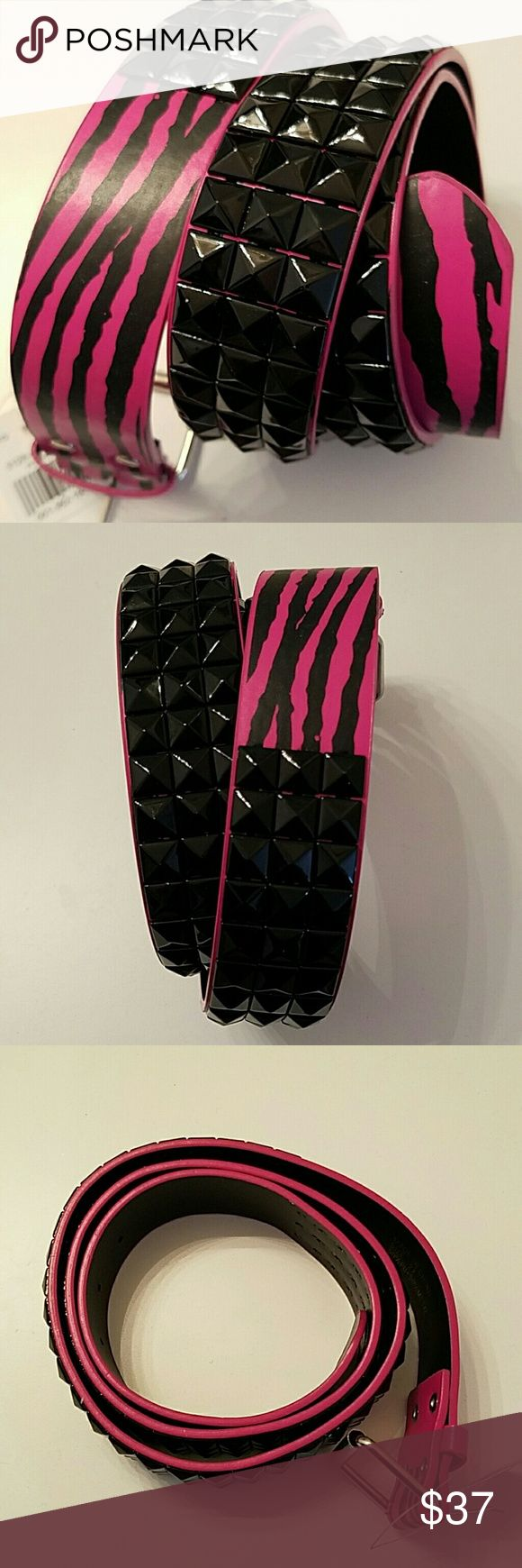 Black studded belt Zebra plus size 2X Offered is a punk fuchsia Zebra print belt with triple row black pyramid studs. New with tags and in immaculate condition. Plus size 2X. Add a little hardcore bling to any outfit. Pyramid studs show minimal shelf wear from being in my belt drawer but it's not noticeable during wear. Accessories Belts