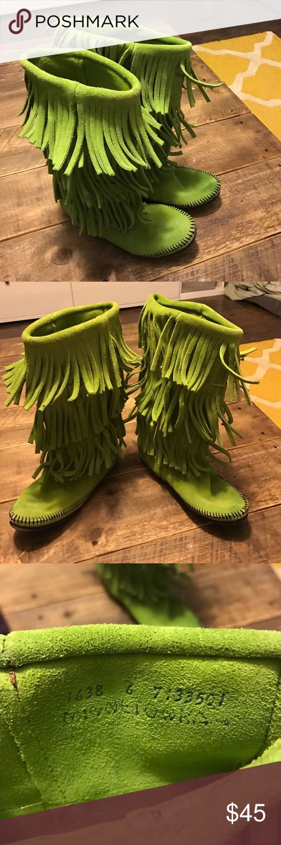 Minnetonka green boots Never worn. Size 6 Minnetonka Shoes Moccasins