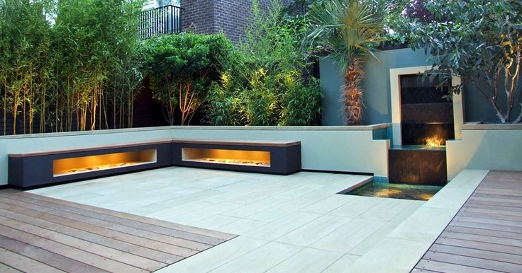 Corner Side Modern Bench With Internal Light Beside The Outdoor Garden And Clam Waterfall In The Patio.