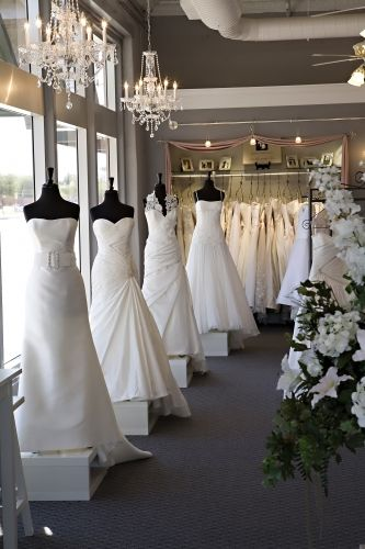 Liked how these dresses were elevated on white shiny boxes. I think even white shiny lacquered boxes for the girls to stand on with their dresses. Maybe even marbled paint effect too. Kim