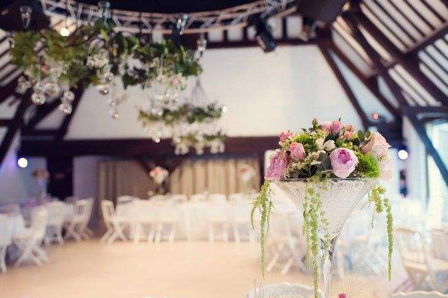 Elegant centre piece in tall martini glasses with flowers