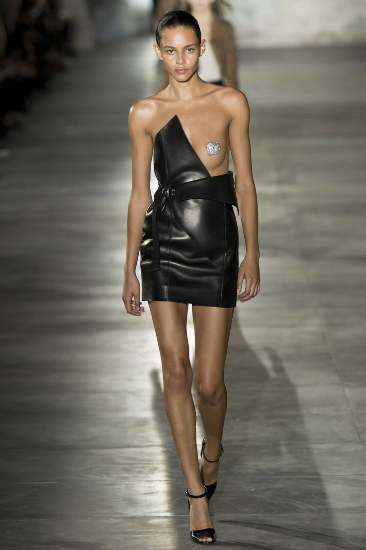 Among the slinky, sultry, and sheer dresses parading down the catwalk at Anthony Vaccarello's Saint Laurent debut was one that stood out from the pack.