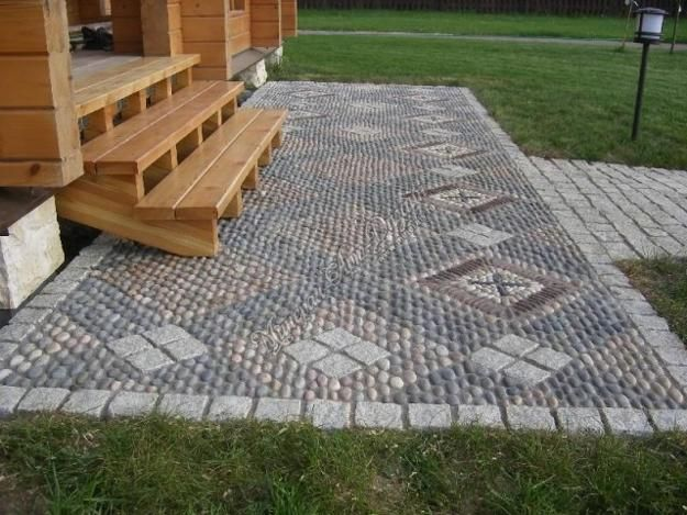 25 beautiful landscaping ideas adding beach stones to for Mosaic landscape design