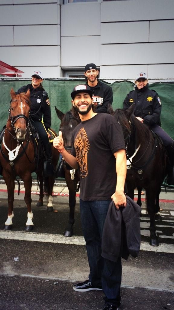 10/31/14. World Series MVP Madison Bumgarner sits atop a SFPD police horse, while teammate Michael Morse takes in the whole scene. MadBum actually wanted to ride a horse in the World Series parade, but was denied due to safety/security concerns.