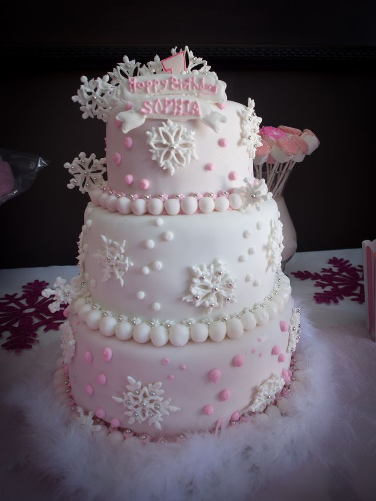 Sophia's winter ONEderland first birthday pink and white snowflake cake