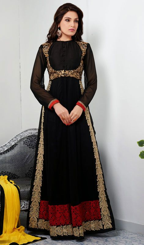 Black Georgette Embroidered Long Churidar Suit Create a stir amongst the people flaunting your stylishness in this black georgette embroidered long churidar suit. Lovely aari, resham and stones work a vital feature of this attire. #ChuridarSuitsInIndia #BuyIndianSuits