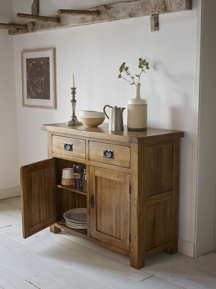 The Original Rustic Solid Oak Sideboard is an elegant piece of furniture, which will provide not only ample storage but rustic farmhouse charm to the dining area or kitchen. The small sideboard has two drawers over two cupboards, and the solid oak top has handsome wooden dowel detailing and chamfered edges.