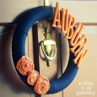 Art Adorn a simple yarn wreath with fabric flowers and some painted wooden letters. WVU would look great!!!!! wvu