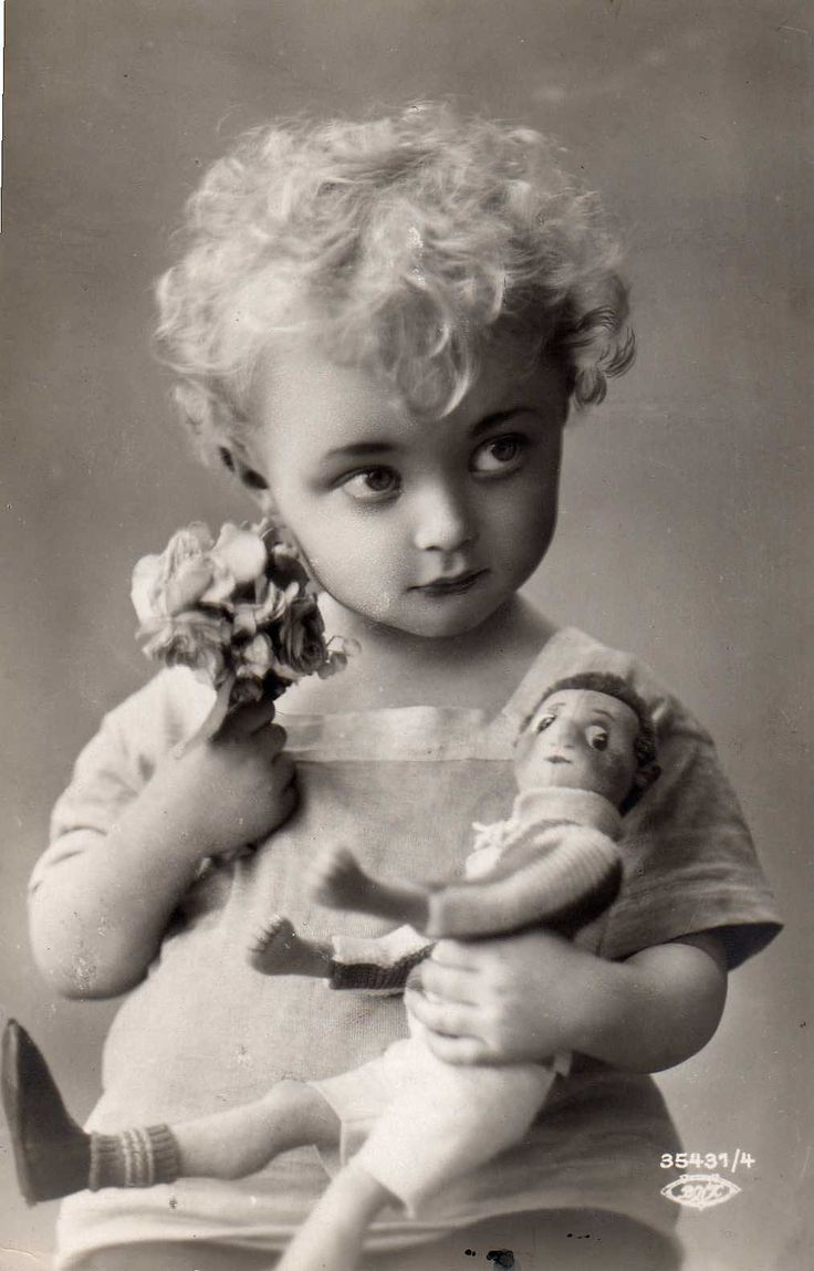 1925 Little girl with her doll.