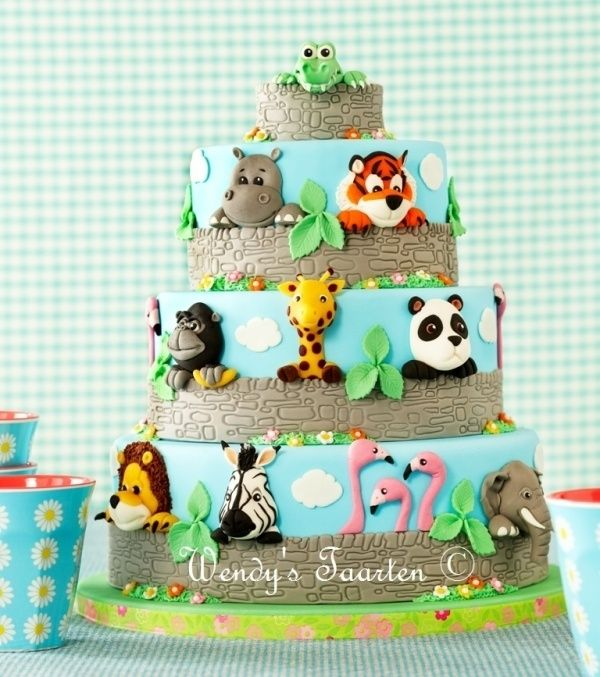 """Fantastic """"Going to the zoo"""" cake by Wendy's Taarten on Cake Central. I love the idea of having the animals peeping over the wall!:"""