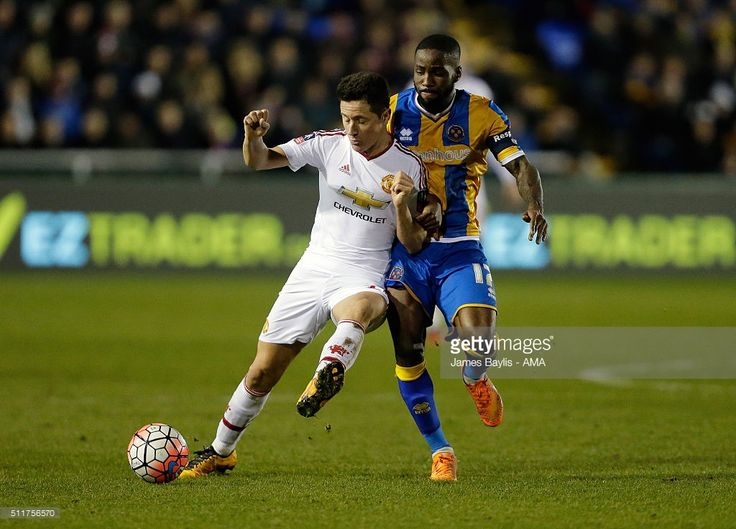 Ander Herrera of Manchester United and Abu Ogogo of Shrewsbury Town during the Emirates FA Cup match between Shrewsbury Town and Manchester United at New Meadow on February 22, 2016 in Shrewsbury, England.