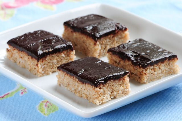 Raw Halvah    1 1/2 cups sesame seeds  3 tablespoons coconut butter, softened  1/2 cup coconut, dried, unsweetened  1/3 cup honey  Ganache recipe here: Chocolate Ganache    1. Mix together all ingredients except ganache.    2. Pat into 8″ square pan.    3. Refrigerate to set.    4. Top with chocolate ganache, return to refrigerator to set chocolate.    5. Cut into squares.