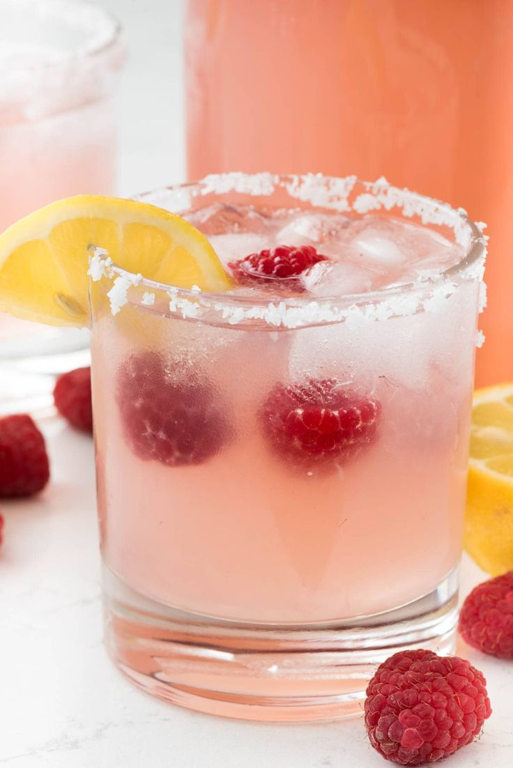 Raspberry Lemonade Margarita - this EASY cocktail recipe is the perfect margarita! Raspberry Lemonade, tequila, and triple sec- that's all it takes!