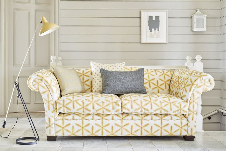 Pale walls and floors with a burst of colour from this saffron sofa in Japonica Saffron #scandi #yellow