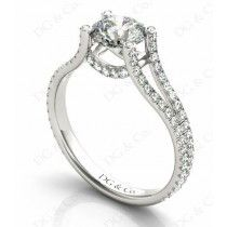 Brilliant cut diamond ring with claw set centre stone