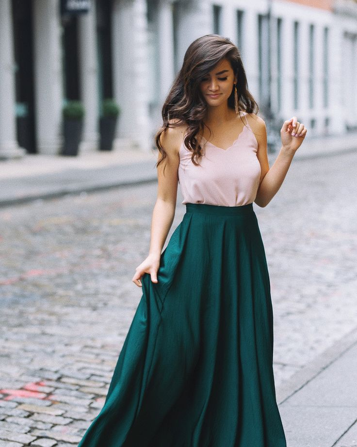 Use pink sweater and teal maxi dress