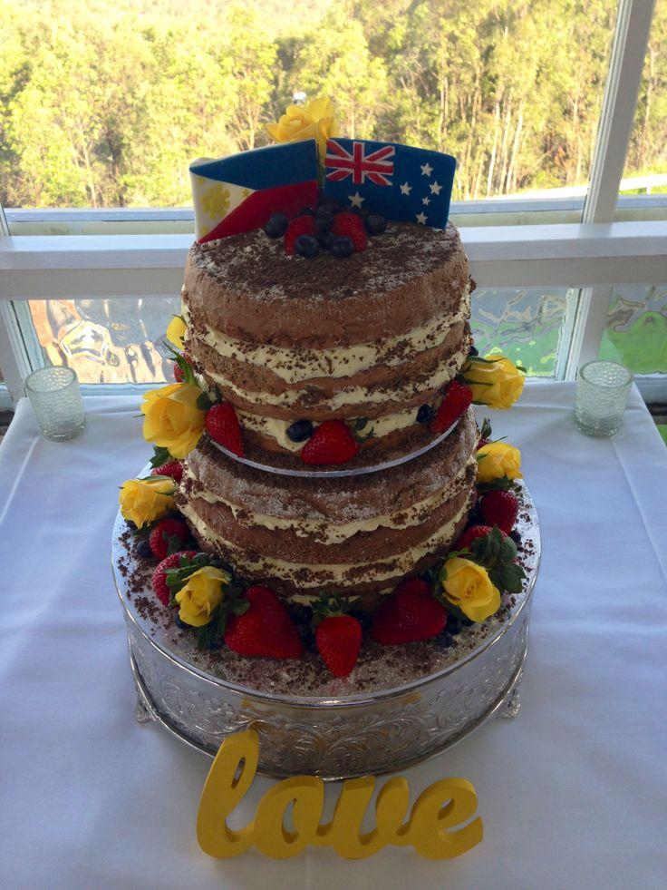 Rustic look nude wedding cake. Grated chocolate sponge with vanilla cream.