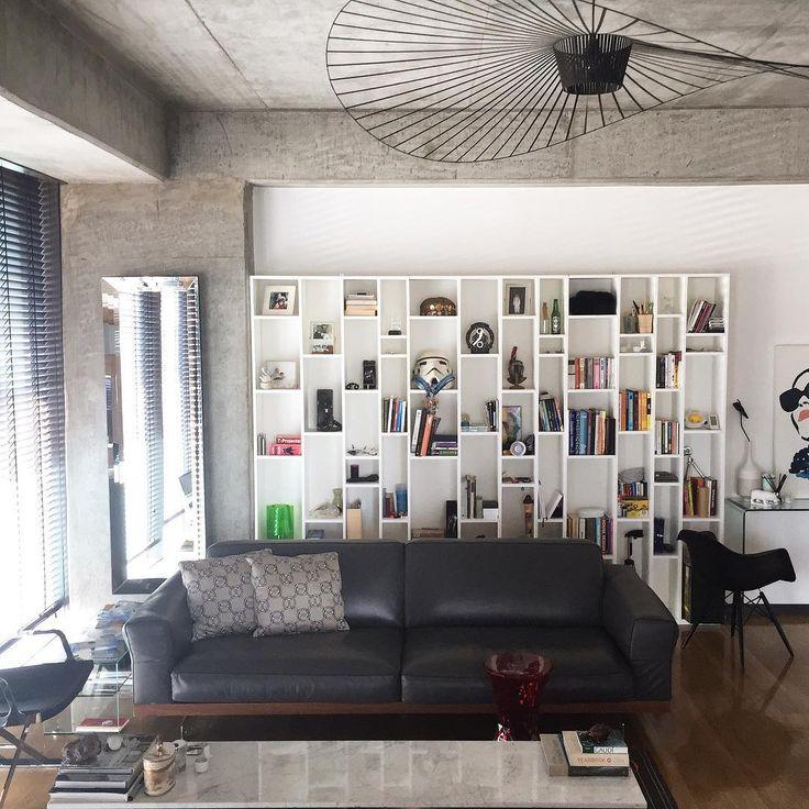 Vertigo lamp by Petite Friture | SC Residence | Levent Loft Istanbul , Turkey . Living room by by Gsc Design | Interiors | Atelier #book #shelve #minimalist #interior #design #masculine #concrete #wall