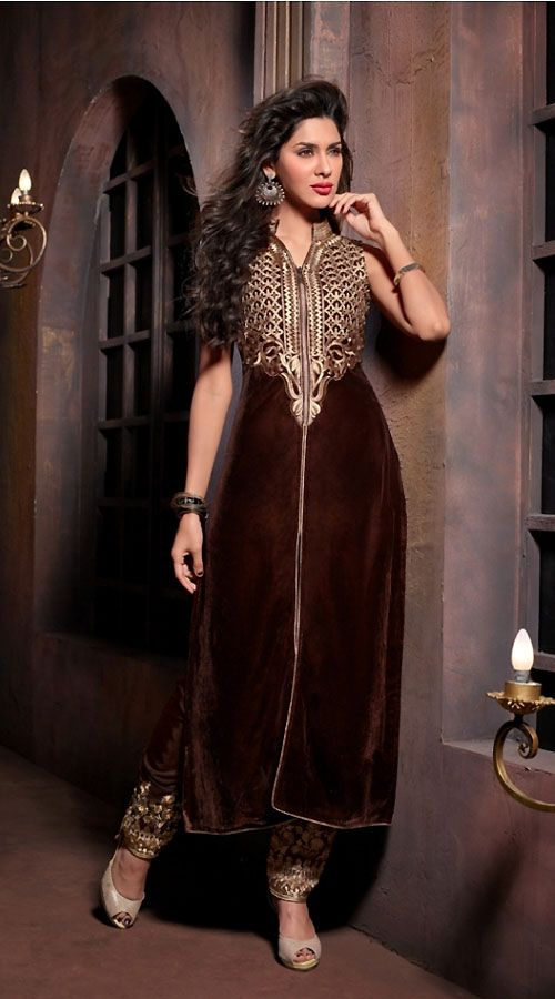 Trendy dark brown pure velvet designer salwar kameez which is adorned with zari embroidery work on the yoke and lace work on the hemline. This suit comes with matching embroidered bottom and dupatta.This unstitched suit can be stitched in the maximum bust size of 42 inches.