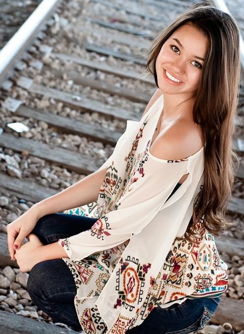Senior picture pose. I don't like her shirt tho...o.o