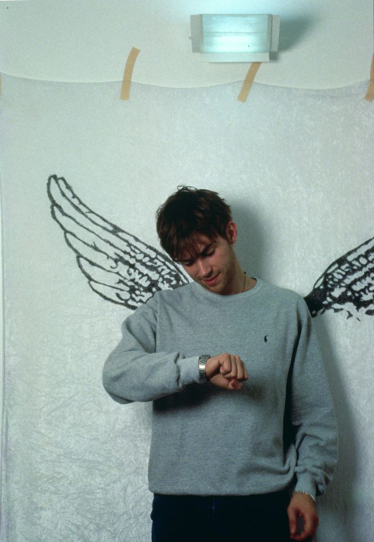 damon albarn with a pair of wing