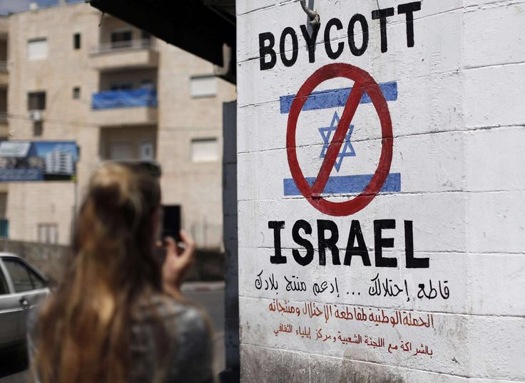 A sign painted on a wall in the West Bank city of Bethlehem on June 5, 2015, calling to boycott Israeli products. Credit: Thomas Coex/AFP