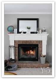 image result for fireplace with wooden mantle and red brick - Moderner Kamin Umgibt Kaminsimse