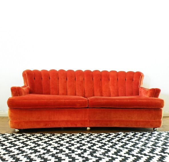 Fabulous Orange Sofa With Aztec Chevron Rug