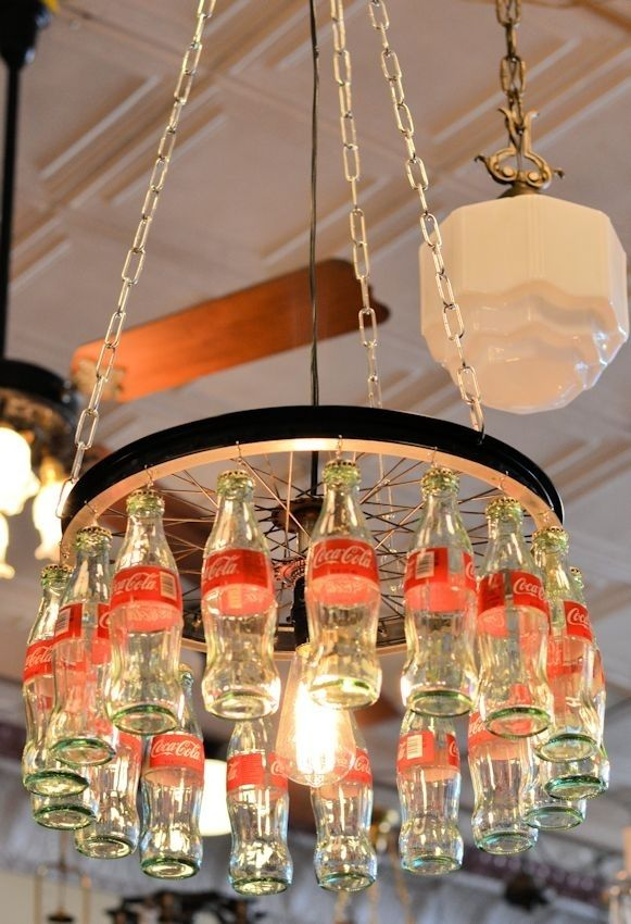 Custom made Coca-Cola chandelier. It is made from a recycled bicycle rim and the small glass Coca-Cola bottles by Cenika