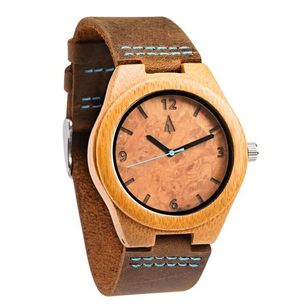 This small wooden Tree Hut watch has genuine brown leather bands and is handmade in San Francisco from real wood. Face of the watch is made from larvish maple burl and blue second hand.